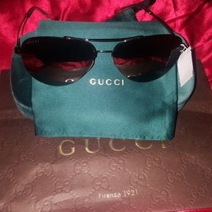 Authentic Gucci Sunglasses with case and bag